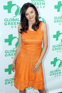 Miranda Kerr sizzles in a bright orange dress on the red carpet for the 'Global Green USA' awards in Santa Monica